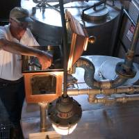 Photo - FILE -- In this Sept. 2003 file photo, Gary Hinshaw tests the proof of the whiskey at the George Dickel Distillery near Tullahoma, Tenn. Alcohol regulators ended their investigation Tuesday, June 10, 2014, into whether George Dickel, a subsidiary of liquor giant Diageo, violated state laws by storing whiskey in neighboring Kentucky. (AP Photo/Mark Humphrey, File)