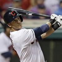 Photo - Cleveland Indians' Yan Gomes watches his RBI double in the seventh inning of a baseball game against the Cincinnati Reds Tuesday, Aug. 5, 2014, in Cleveland. (AP Photo/Mark Duncan)