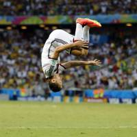 Photo - Germany's Miroslav Klose performs a flip as he celebrates after scoring his side's second goal during the group G World Cup soccer match between Germany and Ghana at the Arena Castelao in Fortaleza, Brazil, Saturday, June 21, 2014. (AP Photo/Frank Augstein)