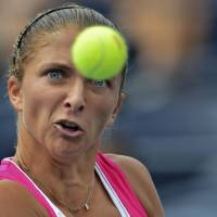 Photo -   Italy's Sara Errani returns a shot to Germany's Angelique Kerber in the fourth round of play at the 2012 US Open tennis tournament, Monday, Sept. 3, 2012, in New York. (AP Photo/Henny Ray Abrams)