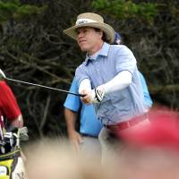 Photo - Briny Baird watches his ball after hitting from the second tee during the final round of the McGladrey Classic golf tournament on Sunday, Nov. 10, 2013, in St. Simons Island, Ga. (AP Photo/Stephen Morton)