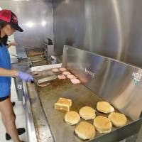 Photo -   Bobbie Sue Tallent cooks hamburgers Thursday at the Dairy Boy Drive-In on SW 3rd Street in Minco. Her parents own the Dairy Boy and she has grown up working at the drive-in. Photo By Steve Gooch, The Oklahoman   Steve Gooch -