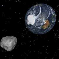 Photo - This image provided by NASA/JPL-Caltech shows a simulation of asteroid 2012 DA14 approaching from the south as it passes through the Earth-moon system on Friday, Feb. 15, 2013. The 150-foot object will pass within 17,000 miles of the Earth. NASA scientists insist there is absolutely no chance of a collision as it passes. (AP Photo/NASA/JPL-Caltech)