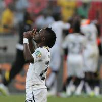 Photo - Ghana's Wakaso Mubarak celebrates after winning their quarter final of the African Cup of Nations soccer match against Cape Verde at the Nelson Mandela Bay Stadium in Port Elizabeth, South Africa, Saturday Feb. 2, 2013. (AP Photo/Themba Hadebe)