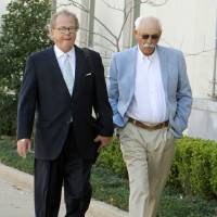 Photo - Admitted bookie Richard Allen Hancock, right, walks Friday with defense attorney John Coyle to Oklahoma City federal court. Hancock pleaded guilty to illegal gambling and money laundering. Hancock said he had eight to 10 subagents who worked under him. He