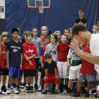 Photo - Campers watch Blake Griffin, left and Coach Mike Moreau during Griffin's basketball camp in Oklahoma City,  August 02, 2011. Photo by Steve Gooch