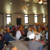 Photo - Members of the metro Sikh community participate in a May 19 worship service and celebration to commemorate the grand opening of the faith community's new house of worship at 4525 NW 16. Photo by Carla Hinton