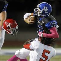 Photo - Carl Albert's Bryan Williams tackles Deer Creek's Joel Blumenthal during the high school football game between Deer Creek and Carl Albert at Deer Creek High School, Friday, Sept. 21, 2012.  Photo by Sarah Phipps, The Oklahoman