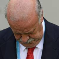 Photo - Spain's head coach Vicente Del Bosque looks down before the start of the group B World Cup soccer match between Spain and Chile at the Maracana Stadium in Rio de Janeiro, Brazil, Wednesday, June 18, 2014. (AP Photo/Manu Fernandez)