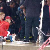 Photo -   A person lays on the ground after high winds blew over a tent near Busch Stadium, Saturday, April 28, 2012, in St. Louis. Severe weather and high winds caused the damage. (AP Photo/KSDK-TV)