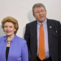 Photo - FILE - This Dec. 4, 2013 file photo shows Senate Agriculture Committee Chair Sen. Debbie Stabenow, D-Mich., left, and House Agriculture Committee Chairman Rep. Frank Lucas, R-Okla. on Capitol Hill in Washington. Farm-state lawmakers are pushing for final passage of the massive, five-year farm bill as it heads to the House floor Wednesday — member by member, vote by vote. There are goodies scattered through the bill for members from all regions of the country: a boost in money for crop insurance popular in the Midwest; higher cotton and rice subsidies for Southern farmers; renewal of federal land payments for Western states. There are cuts to the food stamp program — $800 million a year, or around 1 percent — for Republicans who say the program is spending too much money, but they are low enough that some Democrats will support them.  (AP Photo/J. Scott Applewhite, File)