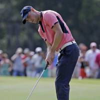 Photo - Martin Kaymer of Germany, watches his putt on the seventh green during the final round of The Players championship golf tournament at TPC Sawgrass, Sunday, May 11, 2014 in Ponte Vedra Beach, Fla. (AP Photo/Lynne Sladky)