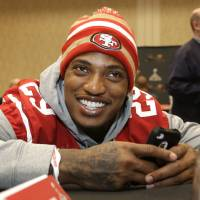 Photo - San Francisco 49ers cornerback Chris Culliver talks with teammates during a media availability Wednesday, Jan. 30, 2013, in New Orleans. The 49ers said Wednesday they have addressed anti-gay remarks made by Culliver during a Super Bowl media day interview Tuesday. The 49ers are scheduled to play the Baltimore Ravens in the NFL Super Bowl XLVII football game on Feb. 3. (AP Photo/Mark Humphrey)