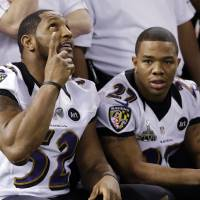 Photo - Baltimore Ravens linebacker Ray Lewis (52)  and Ray Rice pose for a team picture during media day for the NFL Super Bowl XLVII football game Tuesday, Jan. 29, 2013, in New Orleans. (AP Photo/Pat Semansky)