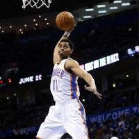 Photo - Oklahoma City Thunder guard Jeremy Lamb (11) goes up for a dunk against the Milwaukee Bucks in the third quarter of an NBA basketball game in Oklahoma City, Wednesday, April 17, 2013. Milwaukee won 95-89. (AP Photo/Sue Ogrocki) ORG XMIT: OKSO113