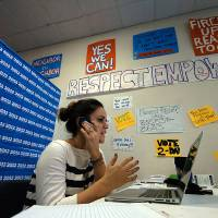 Photo - FILE - In this Nov. 6, 2012 file photo, Taylor Pineiro, of New York, a deputy field organizer for the Obama campaign, works the phone at a field office in Scranton, Pa., on Election Day. Republicans are moving aggressively to repair their technological shortcomings from the 2012 election, opening a new tech race to counter a glaring weakness against President Barack Obama last year.  (AP Photo/Scranton Times & Tribune, Butch Comegys, File)  WILKES BARRE TIMES-LEADER OUT; MANDATORY CREDIT