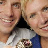 Photo - Ben Barresi holds his late father's 1973 OU Big Eight Championship ring as he and his mother, Janet Barresi, pose for a photo in the Oliver Hodge Building at the state Capitol in Oklahoma City, Friday, July 22, 2011. John Barresi's 1973 Big Eight Championship ring, which was stolen 17 years ago, was recently recovered by State Trooper Jason McAlister. Photo by Nate Billings, The Oklahoman ORG XMIT: KOD
