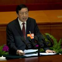Photo - Ma Kai, secretary-general of the State Council, speaks during a plenary session of the National People's Congress held at the Great Hall of the People in Beijing, China, Sunday, March 10, 2013.  Ma read out the report on the Cabinet's plan to streamline government ministries, doing away with the powerful Railways Ministry and creating a super-agency to regulate the media and realigning other bureaucracies in a bid to boost efficiency. (AP Photo/Ng Han Guan)