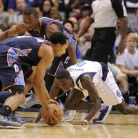 Photo -   Charlotte Bobcats guard Gerald Henderson (9) gets to a loose ball in front of Dallas Mavericks guard Darren Collison (4) and Bobcats guard Kemba Walker (15) in the first half during an NBA basketball game on Saturday, Nov. 3, 2012, in Dallas. (AP Photo/Matt Strasen)