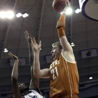 Photo - Texas forward Connor Lammert (21) shoots against TCU forward Connell Crossland (2) during the first half of an NCAA college basketball game Tuesday, Feb. 19, 2013, in Fort Worth, Texas. (AP Photo/LM Otero)