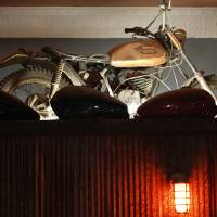 Photo - A motorcycle serves as a decoration at Grandad's Bar, 317 NW 23. Photo by Doug Hoke, The Oklahoman  DOUG HOKE