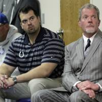 Photo -   Indianapolis Colts owner Jim Irsay, right, general manager Ryan Grigson, center, and interim head coach Bruce Arians listen as a doctor talks about head coach Chuck Pagano, who has been diagnosed with acute promyelocytic leukemia, during an NFL football news conference at the team's headquarters in Indianapolis, Monday, Oct. 1, 2012. (AP Photo/Michael Conroy)