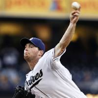 Photo - San Diego Padres starting pitcher Robbie Erlin works against the Kansas City Royals during the first inning of a baseball game Tuesday, May 6, 2014, in San Diego. (AP Photo/Lenny Ignelzi)