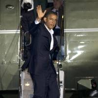 Photo -   President Barack Obama waves as he exits the Marine One helicopter on the South Lawn of the White House in Washington, Friday, Nov. 2, 2012, after days of campaigning. (AP Photo/Jacquelyn Martin)