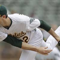 Photo -   Oakland Athletics' Brandon McCarthy follows through on a pitch to a Los Angeles Angels batter in the first inning of a baseball game Wednesday, Sept. 5, 2012, in Oakland, Calif. (AP Photo/Ben Margot)