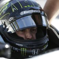 Photo - Race driver Kurt Busch practices at the Indianapolis Motor Speedway during the Rookie Orientation Program in Indianapolis, Tuesday, April 29, 2014. Busch will try to be the first driver in a decade to compete in IndyCar's Indianapolis 500 and Sprint Cup's Coca-Cola 600 on the same day. (AP Photo/Michael Conroy)