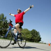 Photo - CELEBRATION: Kevin Mather of Bixby, Okla., celebrates as he nears the finish of the 24th Annual Bike MS: The Mother Road Ride at State Capitol, Sunday, Sept. 27, 2009, in Oklahoma City. Photo by Sarah Phipps, The Oklahoman ORG XMIT: KOD