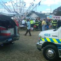 Photo - An amusement park ride malfunctioned Sunday Sept. 8, 2013 at the Norwalk Oyster Festival.  Thirteen children were injured when a festival attraction that swings riders into the air lost power at a community fair in Connecticut but none of the injuries appeared to be life-threatening, authorities said. Most of the children suffered minor injuries and were treated at the Oyster Festival in Norwalk, police said. Norwalk Police Chief Thomas Kulhawik said there were initial reports of serious injuries but preliminary indications are that the injuries were not as severe as first feared. (AP Photo/ The Advocate, David Wells)