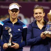 Photo - Simona Halep of Romania, right, and Angelique Kerber of Germany pose with their trophies after the final match of Qatar WTA Ladies Open tennis tournament, in Doha, Qatar, Sunday, Feb. 16, 2014. (AP Photo/Osama Faisal)