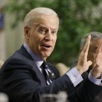 Photo - Vice President Joe Biden gestures during a round table discussion  on gun violence at Virginia Commonwealth University in Richmond, Va., Friday, Jan. 25, 2013.  The panelists included officials who worked on the aftermath of the Virginia Tech shootings.   (AP Photo/Steve Helber)