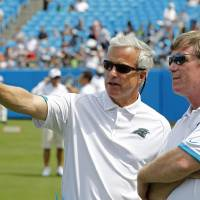 Photo -   FILE - In this Aug. 4, 2012 file photo, Carolina Panthers' team president Danny Morrison, left, talks with general manager Marty Hurney during the NFL Carolina Panthers' Fan Fest football practice in Charlotte, N.C. The Panthers fired Hurney Monday, Oct. 22, 2012 following the team's 1-5 start this season. (AP Photo/Bob Leverone, File)