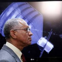 Photo - NASA Administrator Charles Bolden visits to the Jet Propulsion Laboratory in Pasadena, Calif., on Thursday, May 23, 2013. Bolden inspected a prototype spacecraft engine that could power an audacious mission to lasso an asteroid and tow it closer to Earth for astronauts to explore. Bolden's visit comes a month after the Obama administration unveiled its 2014 budget that proposes $105 million to jumpstart the mission, which may eventually cost more than $2.6 billion.  (AP Photo/Nick Ut)