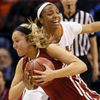 Photo - Oklahoma's Nicole Kornet (1) tries to keep the ball as Texas' Brianna Taylor (20) attempts a steal during a Big 12 women's basketball tournament game between the OU Sooners and Texas at the Chesapeake Energy Arena in Oklahoma City, Saturday, March 8, 2014. Photo by Nate Billings, The Oklahoman