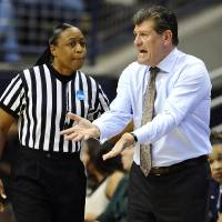 Photo - Connecticut head coach Geno Auriemma, right, speaks with official Felicia Grinter in the first half of a second-round game in the women's NCAA college basketball tournament in Storrs, Conn., Monday, March 25, 2013. Connecticut won 77-44. (AP Photo/Jessica Hill)