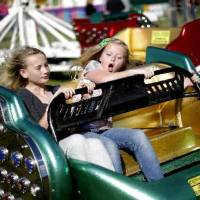 Photo -  Katie Pollard , 11, left, Emma Chesnut, 10, react as they hold on during a ride at the Guthrie 89er Day Celebration, Friday, April 20, 2012. Photo by Bryan Terry, The Oklahoman Archives