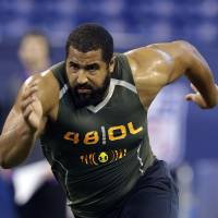 Photo - FILE - In this Feb. 22, 2014, file photo, Penn State offensive lineman John Urschel runs a drill at the NFL football scouting combine in Indianapolis. Urschel will routinely provide a look at his journey leading to the NFL draft on May 8 in a series of diary entries. (AP Photo/Michael Conroy, File)