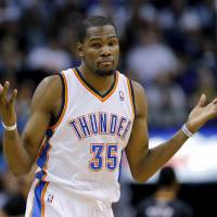 Photo - Oklahoma City Thunder forward Kevin Durant reacts to sinking a 3-pointer during the second half of an NBA basketball game against the Phoenix Suns, Thursday, March 6, 2014, in Phoenix. The Suns won 128-122. (AP Photo/Matt York)