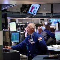 Photo -   Specialist Thomas A. Bishop works the trading floor of the New York Stock Exchange Thursday Sept. 6, 2012. Stocks hit four-year highs Thursday on news of a long-anticipated plan to support struggling countries in the European Union. (AP Photo/David Karp)