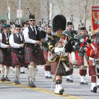 Photo - The Highlanders marched and played traditional instruments in the annual Saint Patrick's Day Parade in downtown Oklahoma City, OK, Saturday, March 16, 2013,  By Paul Hellstern, The Oklahoman