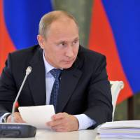 Photo - Russian President Vladimir Putin heads a meeting of commission on energy developing issues and ecological security at the city of Kemerovo Western Siberia on Monday, Aug. 26, 2013. (AP Photo/RIA Novosti, Alexei Nikolsky, Presidential Press Service)
