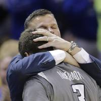 Photo - Creighton head coach Greg McDermott hugs his son Doug McDermott (3) as he leaves the game during the final moments in the second half of a third-round game against Baylor in the NCAA college basketball tournament Sunday, March 23, 2014, in San Antonio. Baylor won 85-55. Creighton's Will Artino is at left. (AP Photo/Eric Gay)