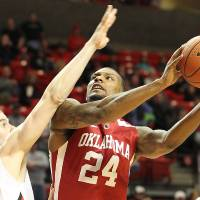 Photo - Oklahoma's Romero Osby shoots against Texas Tech's Robert Lewandowski during their NCAA college basketball game in Lubbock, Texas, Saturday, Feb. 11, 2012. (AP Photo/Lubbock Avalanche-Journal, Zach Long)  ALL LOCAL TV OUT ORG XMIT: TXLUB101