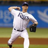 Photo - Tampa Bay Rays starting pitcher Alex Cobb throws during the first inning of a baseball game against the San Diego Padres, Friday, May 10, 2013, in St. Petersburg, Fla. (AP Photo/Mike Carlson)