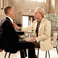 Photo - Daniel Craig, left, and Javier Bardem in a scene from the film