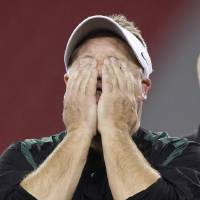 Photo - Oregon head coach Chip Kelly wipes his eyes after the Fiesta Bowl NCAA college football game, Thursday, Jan. 3, 2013, in Glendale, Ariz. Oregon defeated Kansas State 35-17.(AP Photo/Paul Connors)
