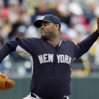 Photo - New York Yankees starting pitcher CC Sabathia throws during the second inning of a spring exhibition baseball game against the Pittsburgh Pirates in Bradenton, Fla., Thursday, March 27, 2014. (AP Photo/Carlos Osorio)